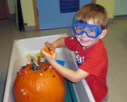 preschool child with pumkin